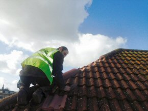 Replacing the ridge tiles blown off in the Gales foundry house, Taunton
