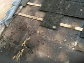 Before picture of a roof that had been damaged during an attempted break in over a shop in Taunton